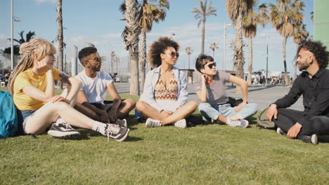 Chilling-young-friends-on-summer-lawn