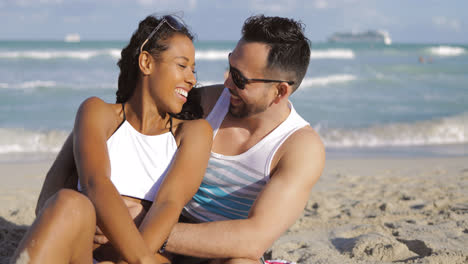 Happy-couple-embracing-on-shore