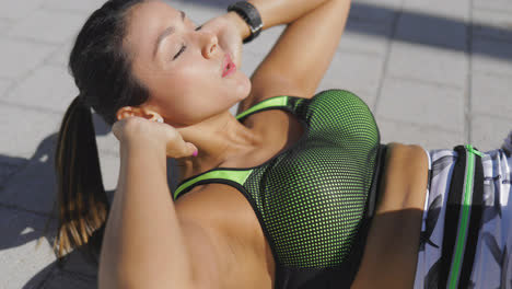 Woman-exercising-abs-on-pavement