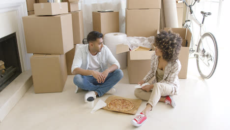 Young-couple-taking-a-break-from-moving-house