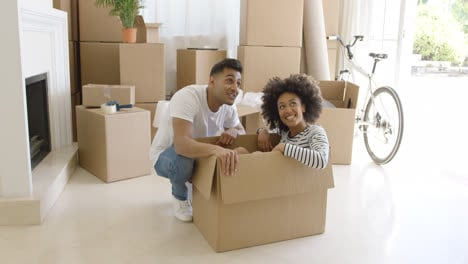 Happy-young-couple-moving-house-together