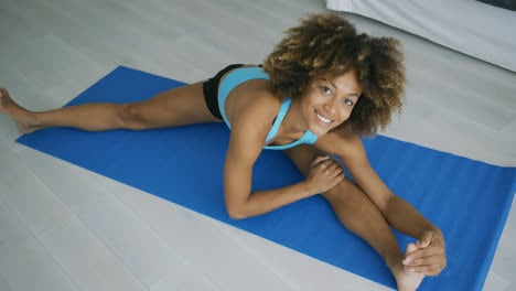 Cheerful-woman-posing-while-stretching