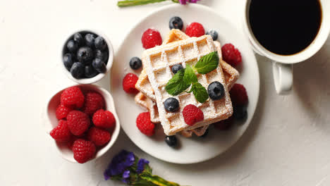 Coffee-and-berries-near-waffles