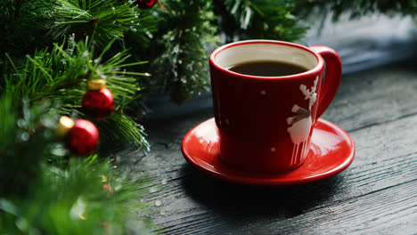 Hot-beverage-near-decorated-conifer-branches