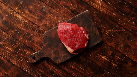 Raw-meat-on-chopping-board
