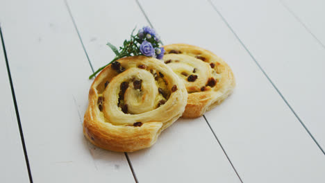 Delicious-pastry-with-raisins-on-white-wooden-table