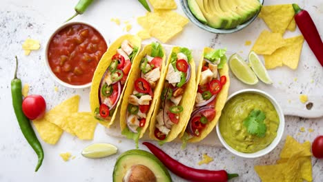 Tasty-Mexican-meat-tacos-served-with-various-vegetables-and-salsa