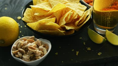 Plate-with-nachos-and-beer