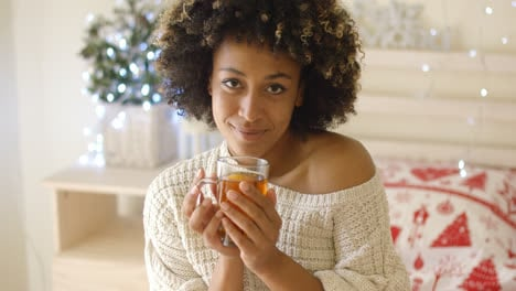 Smiling-woman-holding-hot-tea