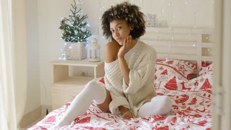 Sexy-young-woman-relaxing-on-her-bed-at-Christmas