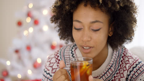 Young-woman-sipping-a-cup-of-hot-lemon-tea