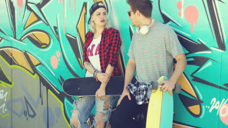 Trendy-modern-urban-couple-chatting-at-skate-park