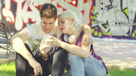 Young-couple-relaxing-in-an-urban-park