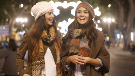 Two-young-woman-enjoying-a-winter-night-out