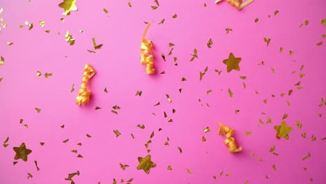 Pink-party-background-with-golden-confetti-and-serpentines