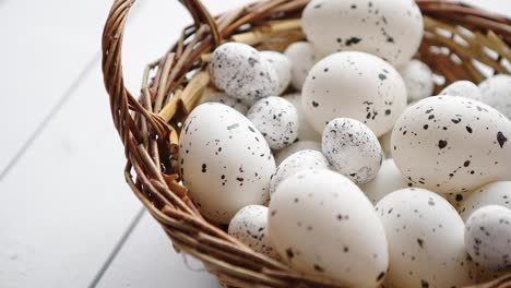 Basket-of-white-dotted-Easter-eggs-in-brown-wicker-basket