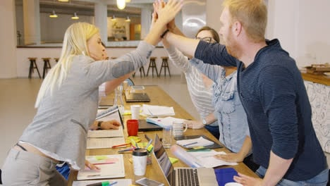 People-high-fiving-in-office