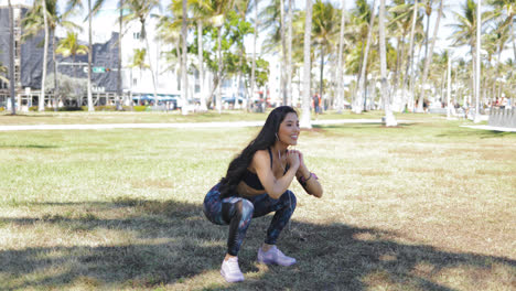Content-sporty-girl-squatting-in-park