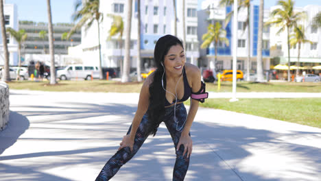 Pretty-happy-sportswoman-training-in-park