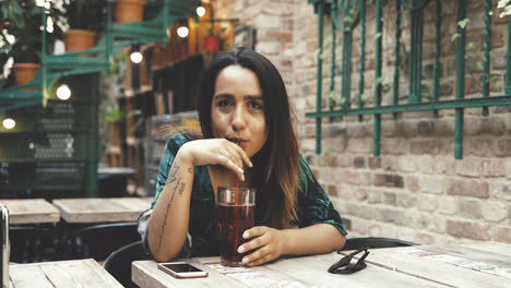 Young-woman-sipping-a-cold-drink