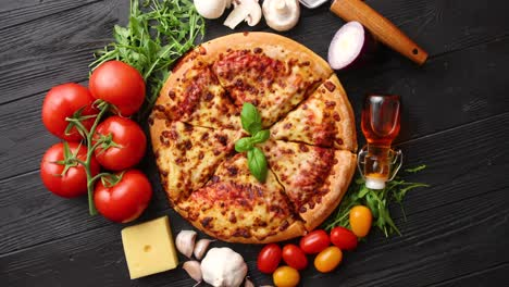 Delicious-italian-pizza-served-on-black-wooden-table