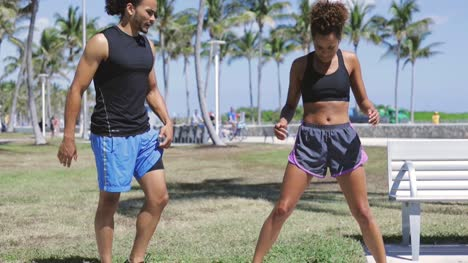 Couple-doing-fitness-in-the-park