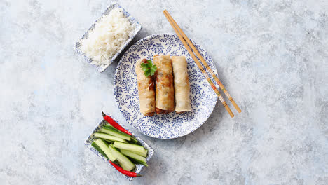 Orginal-asian-deep-fried-spring-rolls-placed-on-beautiful-oriental-style-plate