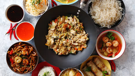 Asian-oriental-food-composition-in-colorful-dishware