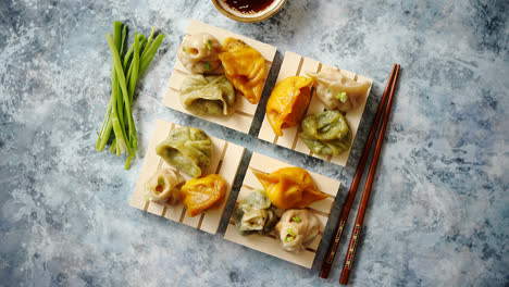 Delicious-mixed-kinds-of-chinese-dumplings-served-on-wooden-stands