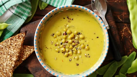 Green-pea-cream-soup-in-grey-bowl