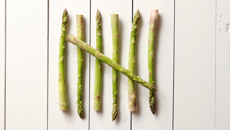 Above-view-of-flat-lay-organic-raw-uncooked-green-asparagus