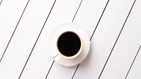Cup-of-hot-beverage-on-table