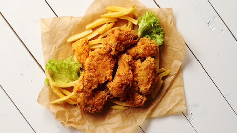 Lettuce-and-French-fries-near-chicken-wings