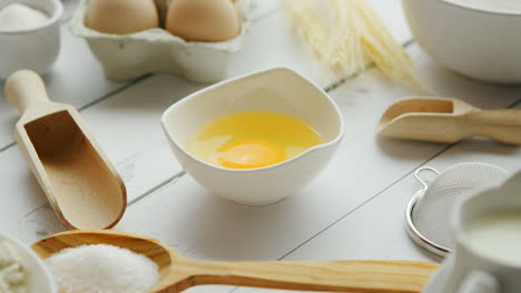 Utensils-and-ingredient-around-bowl-with-yolk