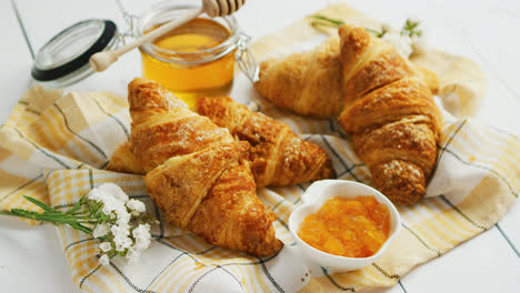 Condiments-and-croissants-lying-on-towel