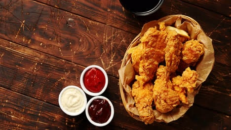Sauces-and-chicken-wings-on-table