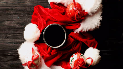 Cup-of-coffee-with-Christmas-hats-around-