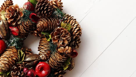 Christmas-Wreath-on-White-Wooden-Background
