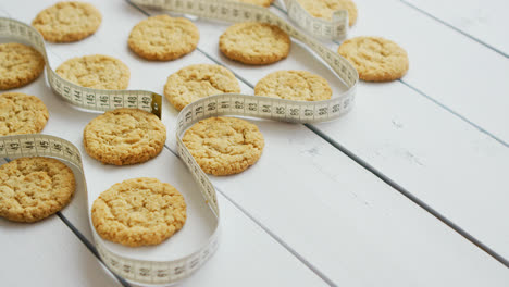 Healthy-oatmeal-cookies-on-white-wood-background-side-view-