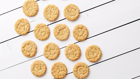 Healthy-oatmeal-cookies-on-white-wood-background-top-view-