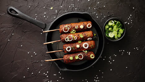 Barbecued-turkey-kebab-decorated-with-fresh-onion