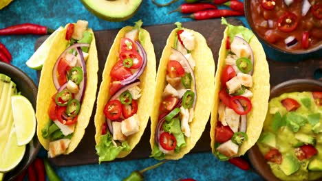 Mexican-taco-with-chicken-meat-jalapeno-fresh-vegetables-served-with-guacamole