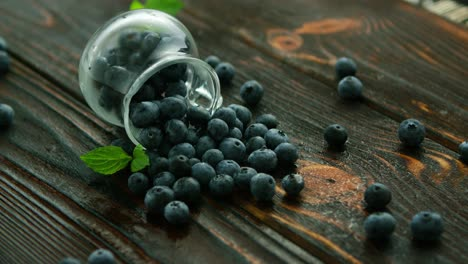 Blueberry-scattering-from-glass-jug