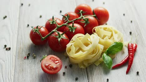 Uncooked-pasta-bunches-with-tomatoes