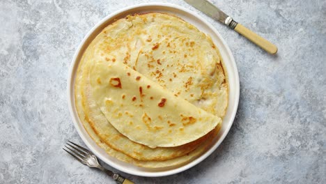 Fresh-homemade-crepes-thin-pancakes-placed-on-white-ceramice-plate