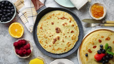 Healthy-homemade-pancake-on-stone-frying-pan-placed-on-table