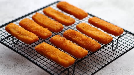 Rows-of-golden-fried-fresh-fish-fingers-fillets