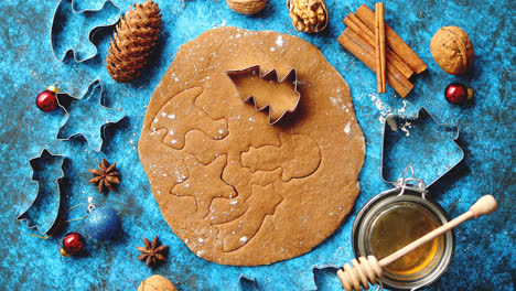Christmas-baking-concept-Gingerbread-dough-with-different-cutter-shapes