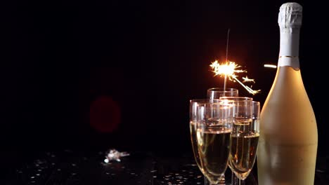 Party-composition-image-Glasses-filled-with-champagne-placed-on-black-table