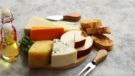 Various-types-of-cheese-served-on-rustic-wooden-board